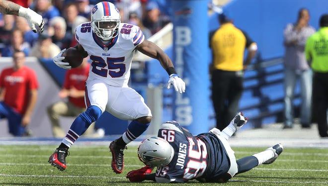 Bills running back LeSean McCoy slips a tackle by Patriots Chandler Jones earlier this season.