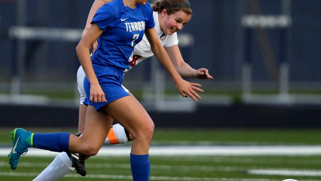 Annika Bard of Appleton West, front, and Mackenzie Larsen of Appleton East race for the ball during a Fox Valley Association game May 1 at Appleton East High School.