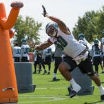 Aug 2, 2015; Philadelphia, PA, USA; Philadelphia Eagles linebacker Marcus Smith (90) attacks a tackling obstacle during training camp at NovaCare Complex. Mandatory Credit: Bill Streicher-USA TODAY Sports