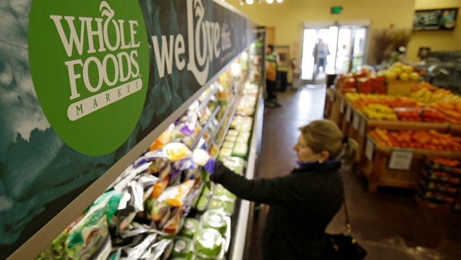 A woman shops at the Whole Foods Market in Woodmere Village, Ohio, on March 27, 2014.