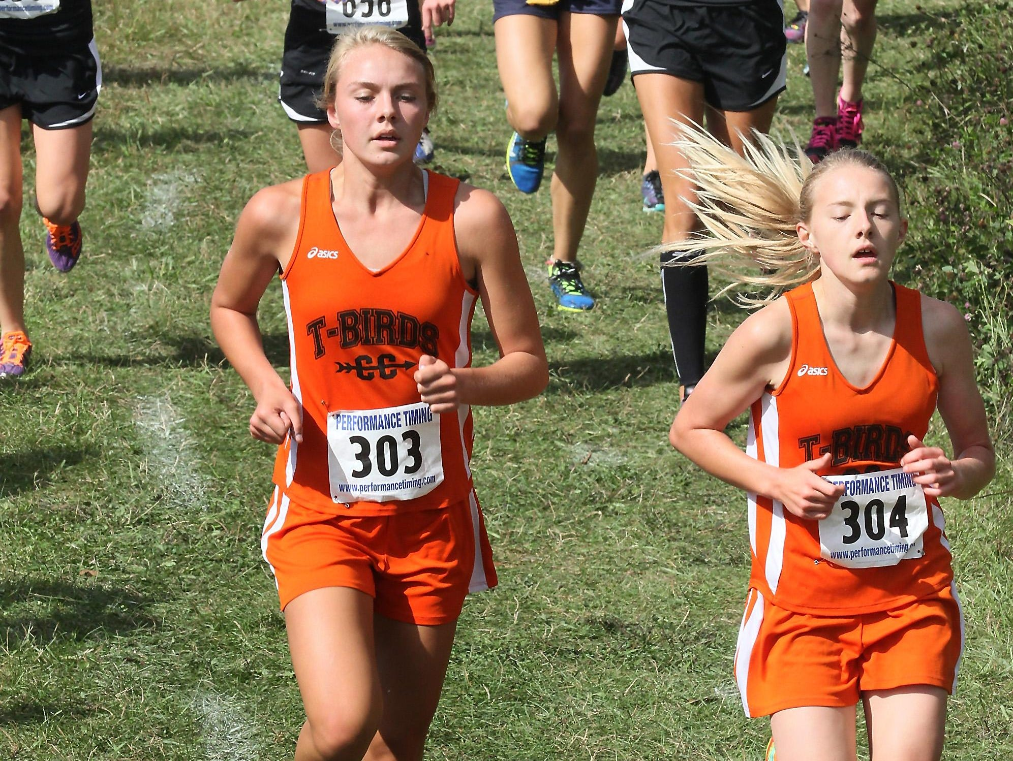 Leighten Fischer, Iola, left and Erika Kisting lead the field early in the the SPASH Invitational Saturday at Standing Rocks County Park near Plover.