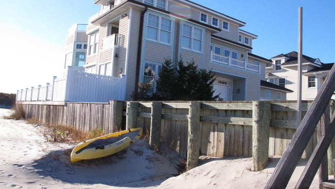 This Dec. 2, 2016 photo shows a wooden bulkhead in Margate N.J., which has been fighting a plan by New Jersey and the federal government to build protective sand dunes between the ocean and the bulkhead.