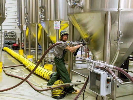 Eamon McCarthy, cellarman, centrifuges a batch of Grapefruit