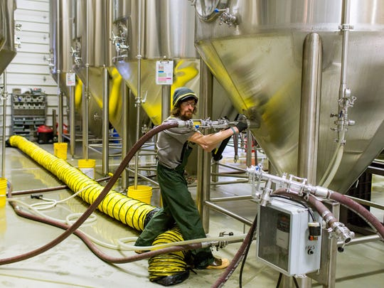 Eamon McCarthy, cellarman, centrifuges a batch of Grapefruit IPA at Perrin Brewing Company in Comstock Park, Mich. on Thursday, Feb. 23, 2017.