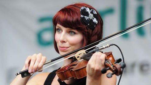 Atlantic Wave musician Kaitlin Hahn plays fiddle during a performance by the Milwaukee-based Irish band.