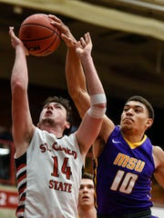 St. Cloud State's  Andy Foley, 14, has his rebound