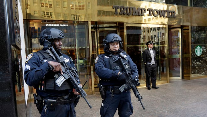 In this Nov. 11, 2016 file photo, New York City Police officers guard the front of Trump Tower in New York.