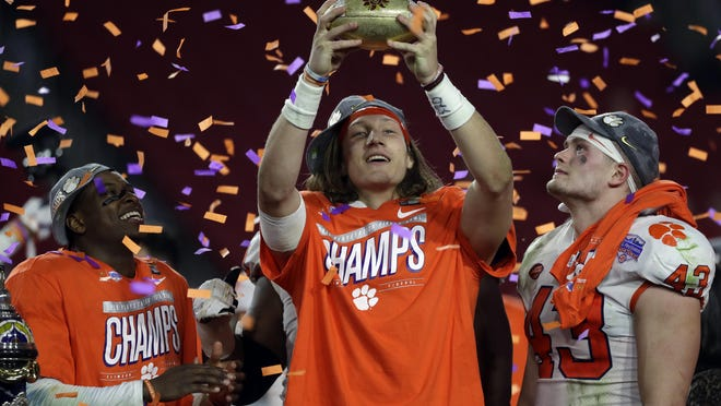Clemson quarterback Trevor Lawrence celebrates after the Tigers victory over Ohio State in the CFP semifinal in the Fiesta Bowl. (AP Photo/Rick Scuteri).