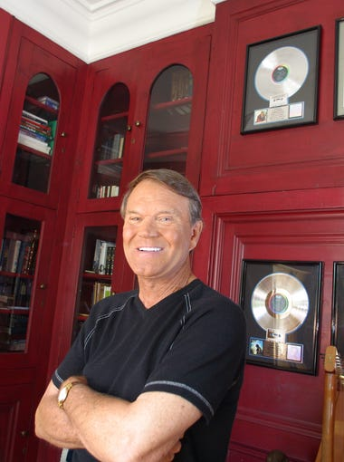 Glen Campbell is seen with his some of his awards at his office in the Biltmore neighborhood in Phoenix in September 2003.