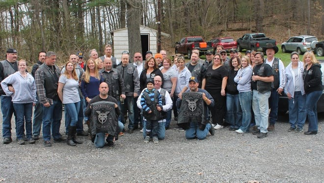 The Allegiance LE Motorcycle Club, recently honored for their community service. Young Ithaca Police Department Officer Colin Hayward Toland is front and center.