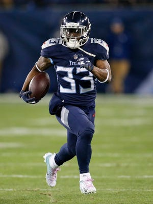 From Dec. 6, 2018, Tennessee Titans running back Dion Lewis (33) runs against the Jacksonville Jaguars during the first half of an NFL football game in Nashville, Tenn. Lewis is in a very familiar role being Saquon Barkley's backup with the New York Giants. It's a role Lewis occupied the past two seasons in Tennessee, spelling NFL rushing leader Derrick Henry.