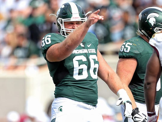 Michigan State Spartans center Jack Allen (66) gestures