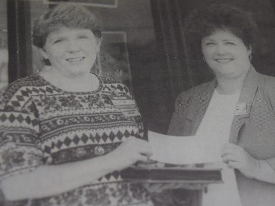 Lisa Hunt, left, of the Wal-Mart support management