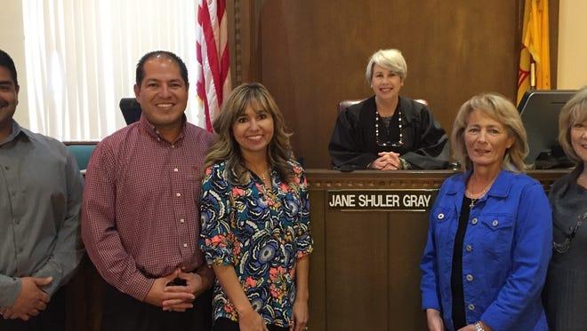 Judge Jane Shuler Gray swore in a new batch of CASA volunteers. Pictured, left to right, Richard Dominguez, Joel Longoria, Melanie Longoria,  Judge Jane Shuler-Gray, Anita Hitchens and Brenda Northcutt.