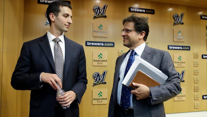 Brewers owner Mark Attanasio (right) has given GM David Stearns (left) the green light to increase the payroll in 2018.