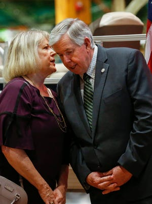 Teresa Parson leans in to talk with her husband, Gov. Mike Parson, in May at Bass Pro Shops in Springfield.