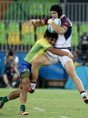 Brazil back Moises Duque (6) wraps up United States forward Garrett Bender (4) during a rugby sevens match between USA and Brazil on Tuesday at Deodoro Stadium in the Rio 2016 Summer Olympic Games.