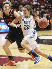 FGCU's Jenna Cobb drives to the basket against Oklahoma State University on Saturday in the NCAA Division I Women's Basketabll Championship first round game at the Donald L. Tucker Civic Center in Tallahhassee. FGCU beat OKU 75-67.