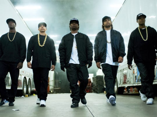 """This photo provided by Universal Pictures shows, Aldis Hodge, from left, as MC Ren, Neil Brown, Jr. as DJ Yella, Jason Mitchell as Eazy-E, O'Shea Jackson, Jr. as Ice Cube and Corey Hawkins as Dr. Dre, in the film, """"Straight Outta Compton."""" The movie released in U.S. theaters on Friday, Aug. 14, 2015."""