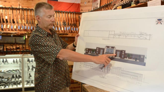 Ed Swadish talks about his new facility which would include a gun range. He received special and use approval from Lyon Township board members on Monday.