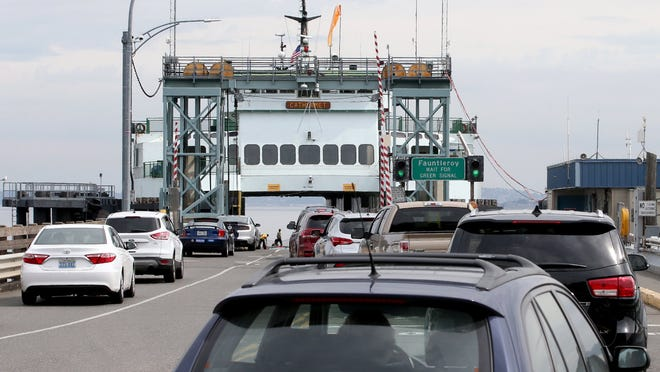 Vehicles move down the lanes ias they board the Cathlamet for a sailing to Fauntleroy at the Southworth ferry dock.