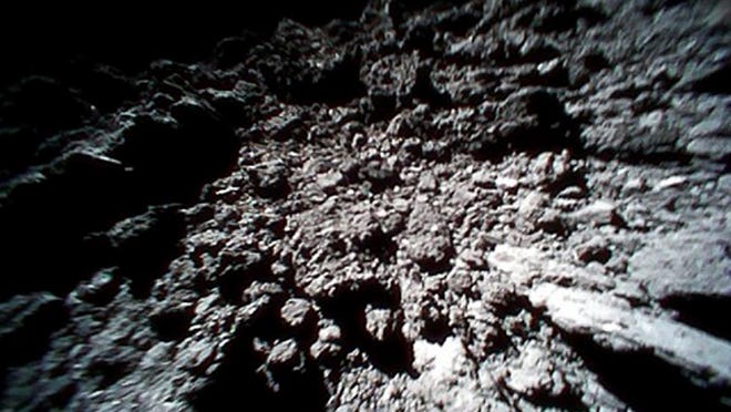 This Sept. 23, 2018 image captured by Rover-1B, and provided by the Japan Aerospace Exploration Agency (JAXA) shows the surface of asteroid Ryugu.