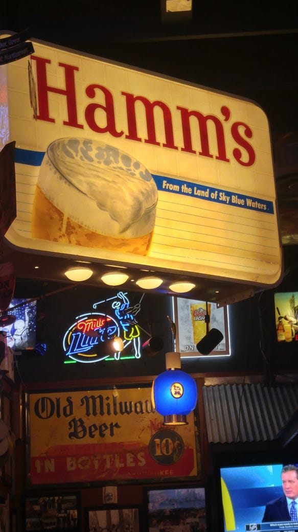 A Hamm's beer sign hangs in Starz, which has a $2 special