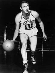 Cliff Barker wore an Indianapolis Olympians uniform