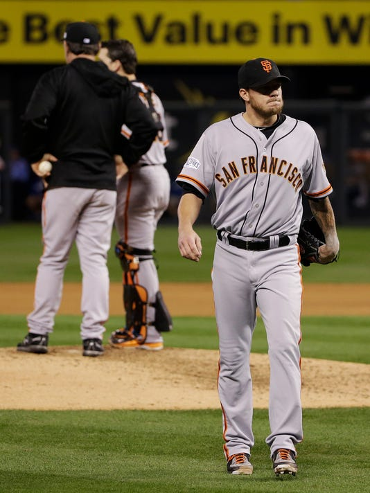 San Francisco Giants pitcher Jake Peavy walks off the field after being relieved by Jean Machi during the sixth inning of Game 2 of baseball's World Series against the Kansas City Royals Wednesday, Oct. 22, 2014, in Kansas City, Mo. (AP Photo/Matt Slocum)