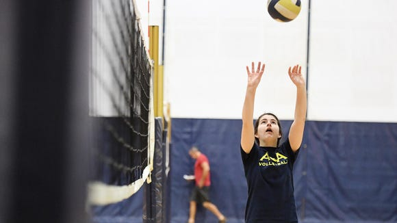 Senior setter Sara Buchanan practices at Asheville Christian Academy September 5, 2017.