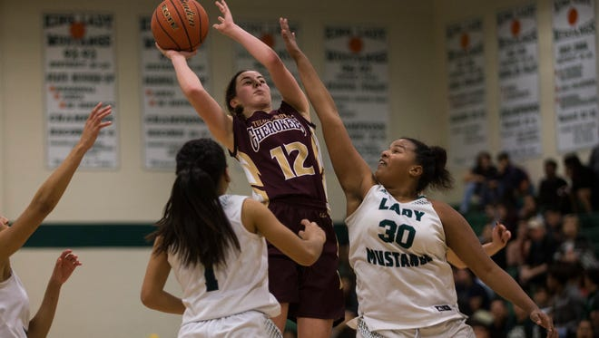Tuloso-Midway's M. Hermes shoots the ball against King's Candice Ellison during their game Tuesday, Dec. 12, 2017, at King High School.