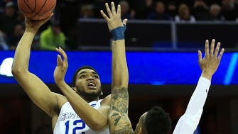 Mar 28, 2015; Cleveland, OH, USA; Notre Dame Fighting Irish forward Zach Auguste (30) guards a shot by Kentucky Wildcats forward Karl-Anthony Towns (12) during the second half in the finals of the midwest regional of the 2015 NCAA Tournament at Quicken Loans Arena. Mandatory Credit: Andrew Weber-USA TODAY Sports ORG XMIT: USATSI-221712 ORIG FILE ID:  20150328_sal_aw3_0094.JPG