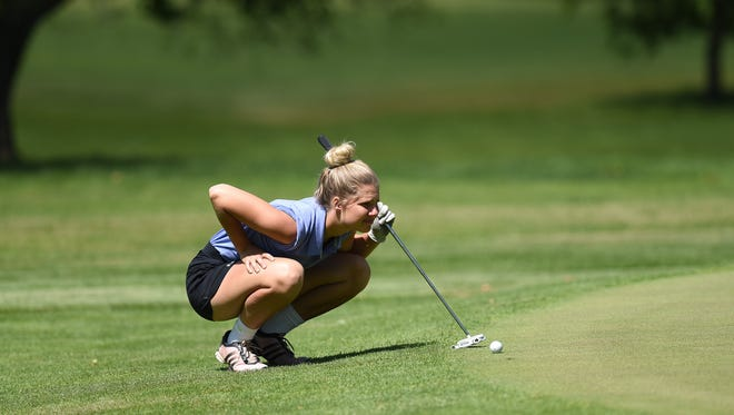 O'Gorman's Jamie Benedict lines up her put during the girls state golf tournament at  Lakeview Golf Course in Mitchell, S.D., Tuesday, June 7, 2016.