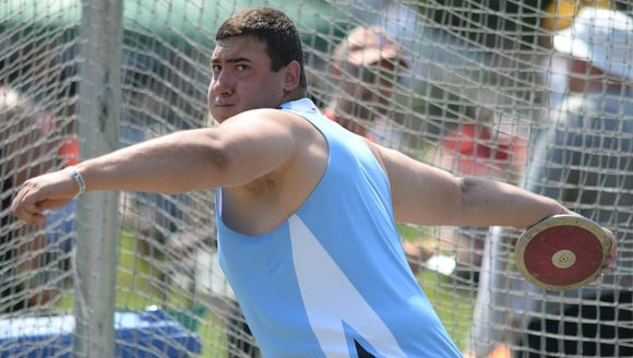 Parsippany Hills' Justin Gurth throws the discus during