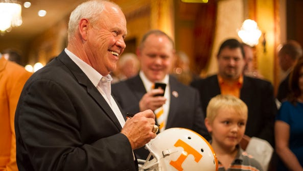 Former Tennessee football coach Phillip Fulmer signs