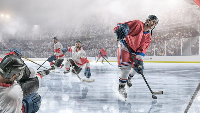 An ice hockey player dribbling puck past rival players during an ice hockey game. The match takes place in a generic floodlit indoor ice hockey arena full of spectators with mist and haze. All players are wearing generic and unbranded ice hockey kit. With intentional water spray and bokeh effects.