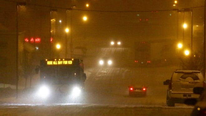 Traffic navigates snowy conditions Friday night on Pennsylvania Avenue in Sheboygan.