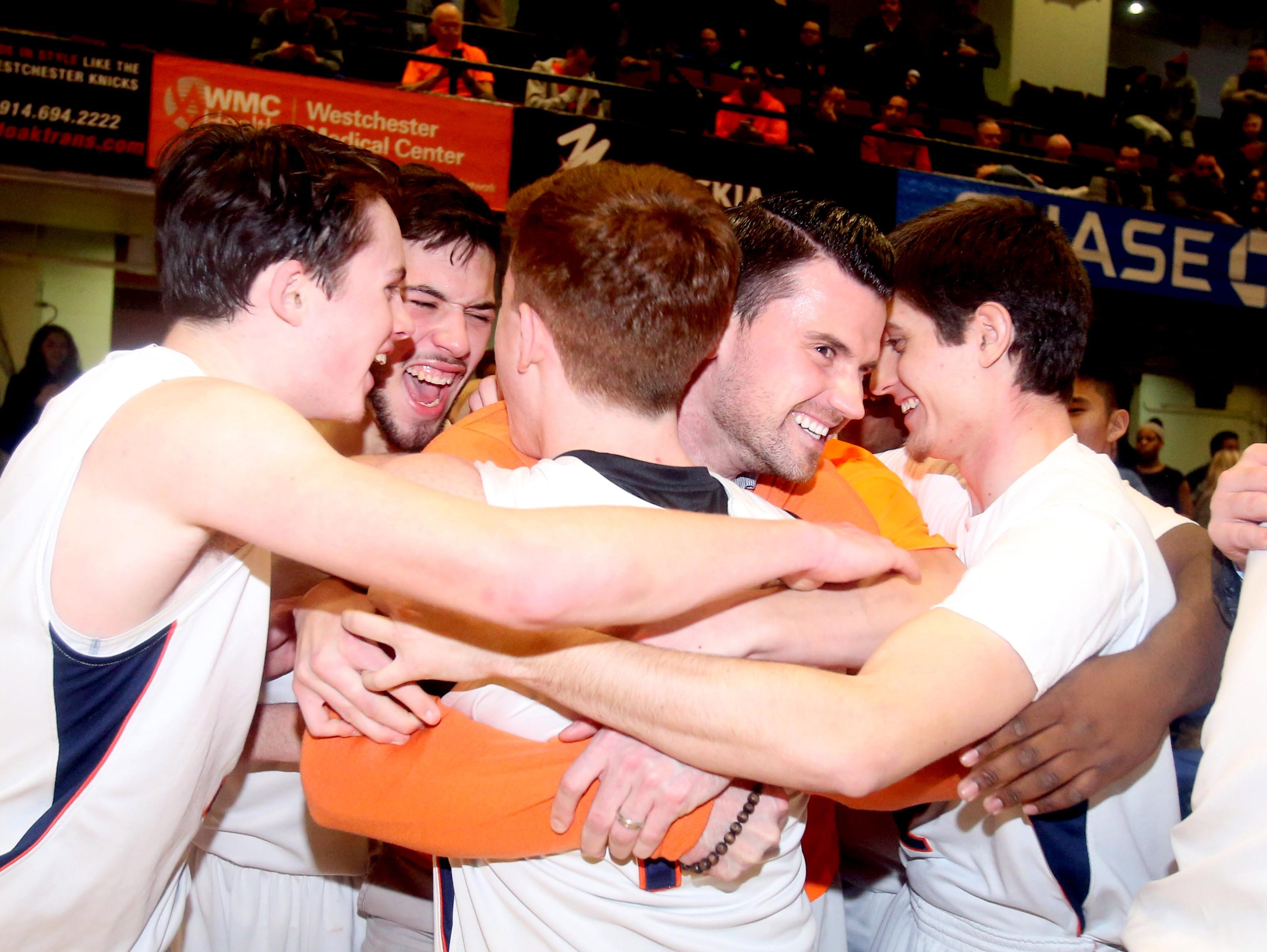 Briarcliff celebrates after defeating Putnam Valley 53-42 to win the Section 1 Class B basketball championship at the Westchester County Center in White Plains Feb. 27, 2016.
