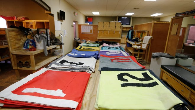 The colors worn by both the jockeys and horses that will run beginning Friday at Sunland Park Racetrack & Casino lay on a table inside the jockey room. Live racing will return to the track for its 59th season.