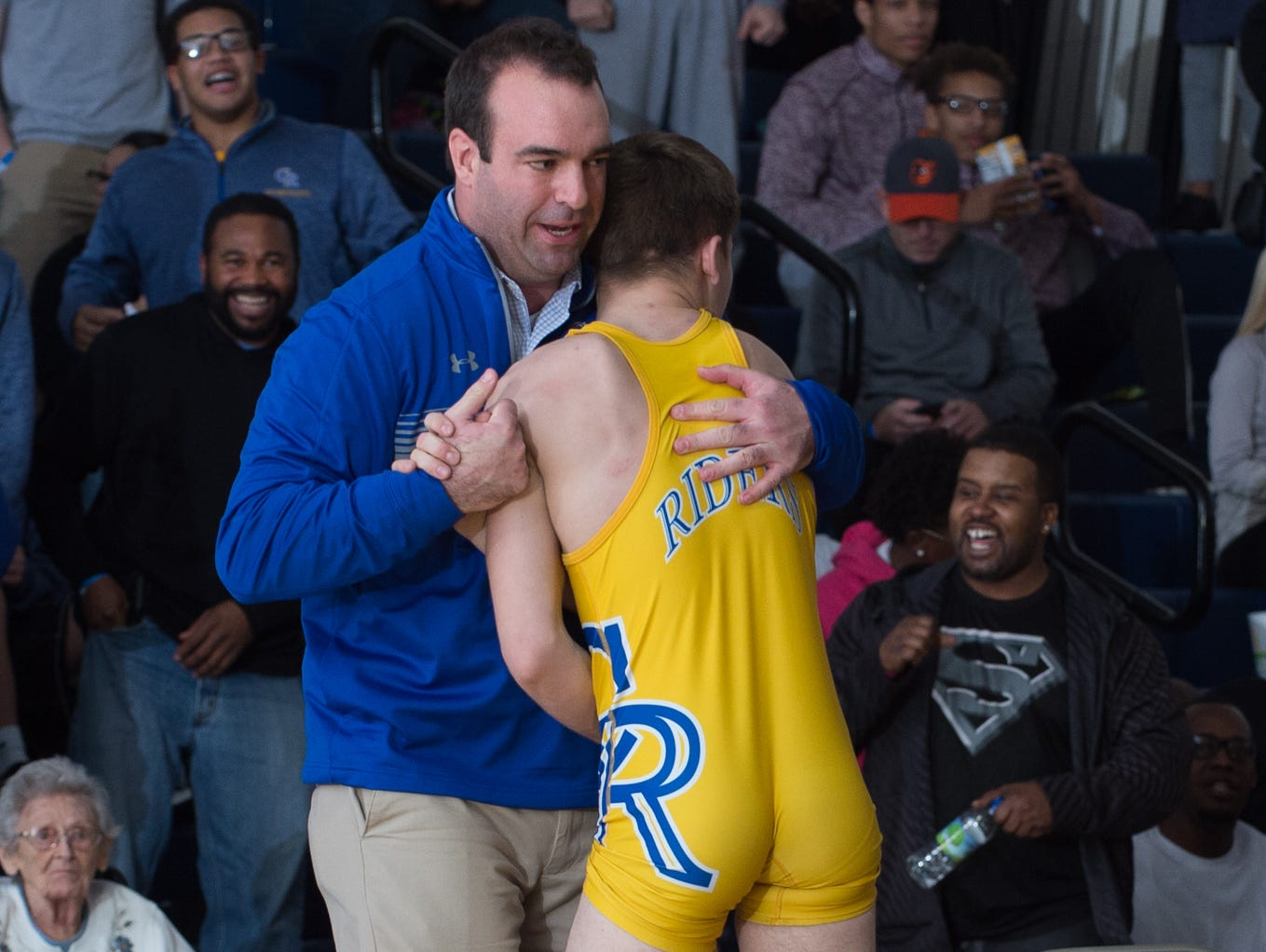 Caesar Rodney's head wrestling coach, Dan Rigby, congratulates Jackson Dean after defeating Smyrna's Greg Baum in the 132 pound championship match at the Henlopen Conference wrestling tournament at Sussex Central High School.