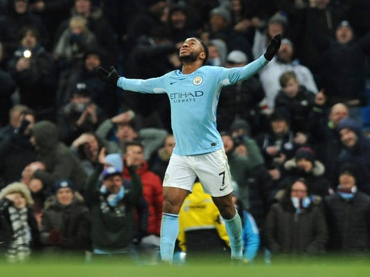 Manchester City's Raheem Sterling celebrates after scoring his side second goal during the English Premier League soccer match between Manchester City and Southampton at Etihad stadium, in Manchester, England, Wednesday, Nov. 29, 2017. (AP Photo/Rui Vieira)