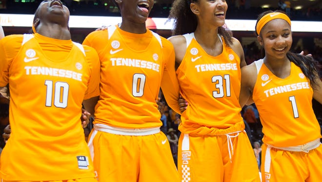 Tennessee's Meme Jackson (10), Rennia Davis, Jaime Nared and Anastasia Hayes come together in celebration Sunday after the Lady Vols' 82-75 victory over Texas at Thompson-Boling Arena.