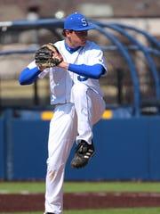 Salem pitcher Tyler Brooks gets set to power the ball