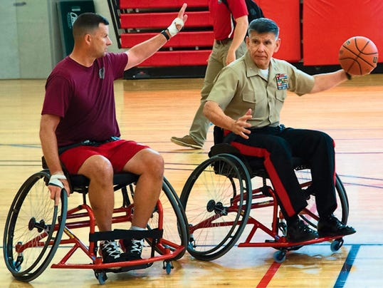 Maj. Gen. Juan Ayala, right, who headed the task force that ran the Warrior Games in Quantico, Va., gets to know some of the athletes. Ayala is from El Paso, having graduated from Coronado High School and UTEP.