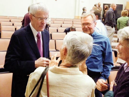 Former U.S. Senator Jeff Bingaman (D-NM) visits with audience members after his talk on climate and energy challeges, hosted by the Western Institute of LIfelong Learning at WNMU on Friday. Randal Seyler - Sun-News