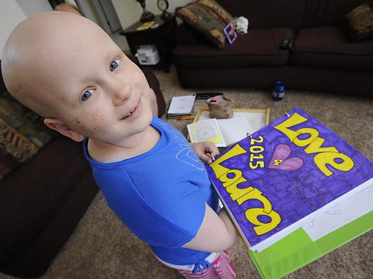 Laura VanDerBos, 12, often drew colorful messages of hope in her sketch book. Laura passed away in November after an eight-year battle with cancer.