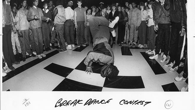 """Teens gathered for a """"Showbiz After Hours"""" dance make a spectators circle in which break dancers take turns strutting their athletic stuff in April of 1985,"""