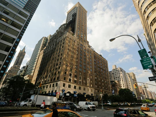 Pedestrians pass the Trump Park Avenue building May