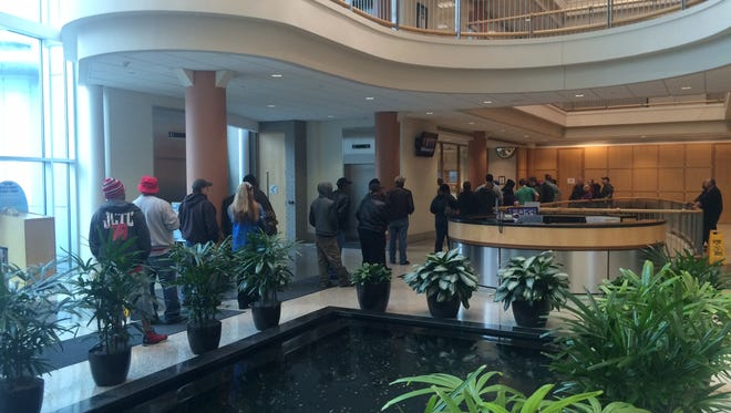 Louisville Water customers waited in line at customer service windows Tuesday