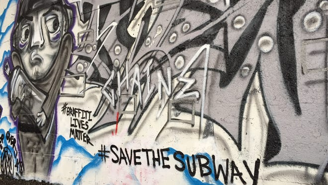 """Graffiti artists pay tribute to the """"Save the Subway"""" movement inside Rochester's abandoned subway tunnel."""